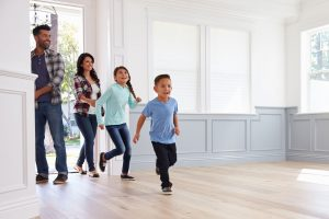 Family entering new home